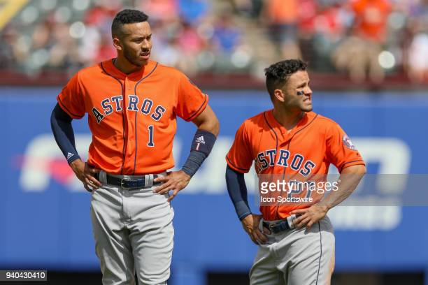 Houston Astros Shortstop Carlos Correa and Second base Jose Altuve look at the scoreboard between inning at the baseball game between the Houston...