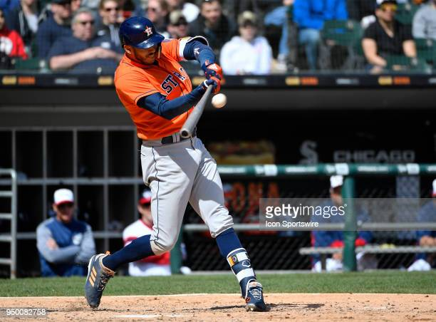 Houston Astros shortstop Carlos Correa hits a sacrifice RBI against the Chicago White Sox on April 22 2018 at Guaranteed Rate Field in Chicago...