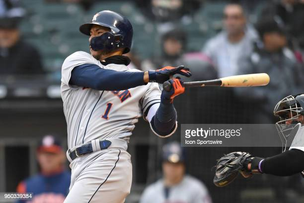 Houston Astros shortstop Carlos Correa hits an RBI single during a game between the and the Houston Astros the Chicago White Sox on April 21 at...