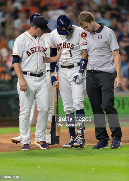 Houston Astros shortstop Carlos Correa leaves the batting box after getting injured during the MLB game between the Seattle Mariners and Houston...