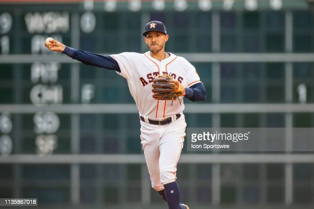 Houston Astros shortstop Carlos Correa makes a throw to first base for the out on New York Yankees catcher Gary Sanchez in the first inning of a MLB...