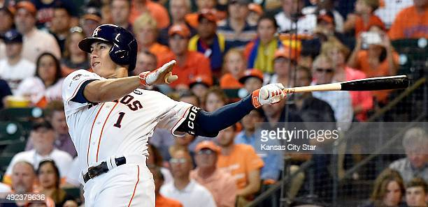 Houston Astros shortstop Carlos Correa smashes a solo home run during the third inning on Monday Oct 12 at Minute Maid Park in Houston