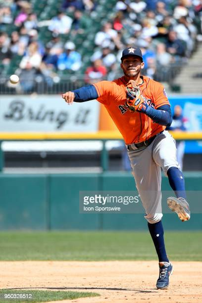 Houston Astros shortstop Carlos Correa throws the ball to first base for an out against the Chicago White Sox on April 22 2018 at Guaranteed Rate...