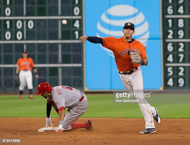 Houston Astros shortstop Carlos Correa turning a double play on Cincinnati Reds center fielder Billy Hamilton during a MLB baseball game, Friday,...