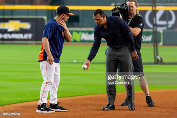 Houston Astros third baseman Alex Bregman and ESPN commentator Alex Rodriquez talking baseball during an ESPN filming prior to a baseball game...