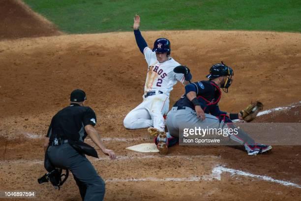 Houston Astros third baseman Alex Bregman beats the throw scoring on a Houston Astros left fielder Marwin Gonzalez single in the sixth inning during...