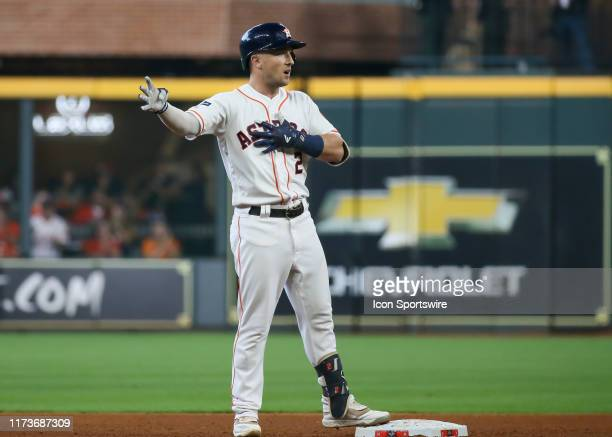 Houston Astros third baseman Alex Bregman celebrates after hitting a double in the bottom of the fifth inning during the ALDS Game 1 between the...
