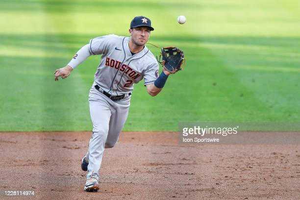 Houston Astros third baseman Alex Bregman fields a ground ball against the Colorado Rockies during a game at Coors Field in Denver, Colorado on...