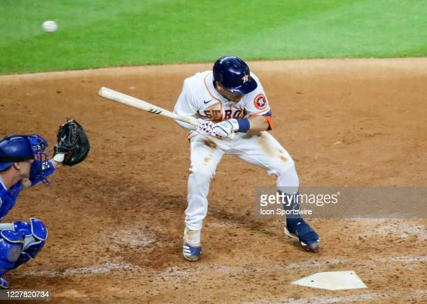 Houston Astros third baseman Alex Bregman gets hit by a pitch during the baseball game between the Los Angeles Dodgers and Houston Astros on July 28,...