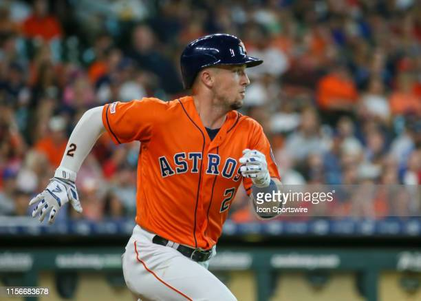 Houston Astros third baseman Alex Bregman hits a single at the bottom of the first inning during the baseball game between the Texas Rangers and...