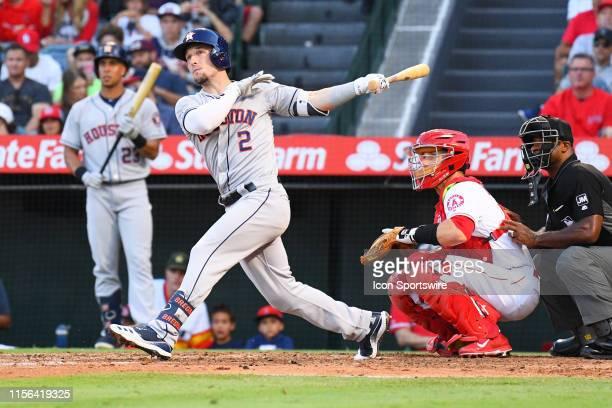 Houston Astros third baseman Alex Bregman hits a solo home run during a MLB game between the Houston Astros and the Los Angeles Angels of Anaheim on...