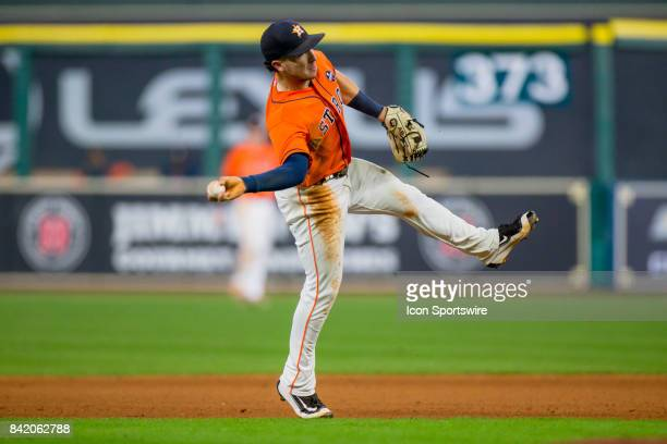 Houston Astros third baseman Alex Bregman off balance throw making a play for the out in the seventh inning during an MLB game between the Houston...
