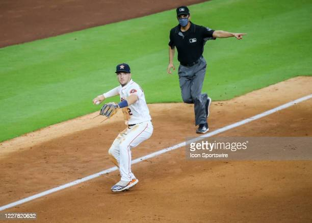 Houston Astros third baseman Alex Bregman prepares to make a play at first base during the baseball game between the Los Angeles Dodgers and Houston...