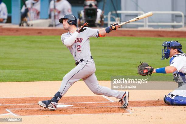 Houston Astros third baseman Alex Bregman swings at a pitch during a MLB game between the Houston Astros and the Los Angeles Dodgers on September 12,...