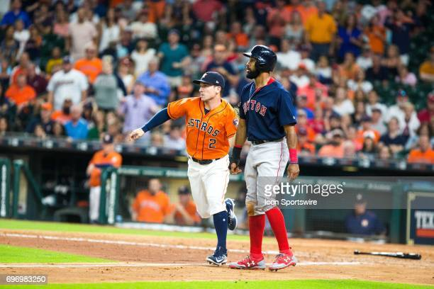 Houston Astros third baseman Alex Bregman tags Boston Red Sox left fielder Chris Young out at home plate in a rundown in the ninth inning of an MLB...