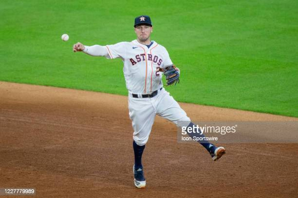 Houston Astros third baseman Alex Bregman throws an off balance throw to first base for an out on Seattle Mariners first baseman Daniel Vogelbach in...
