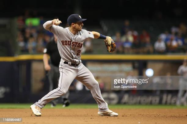 Houston Astros third baseman Alex Bregman throws to first during a game between the Milwaukee Brewers and the Houston Astros at Miller Park on...
