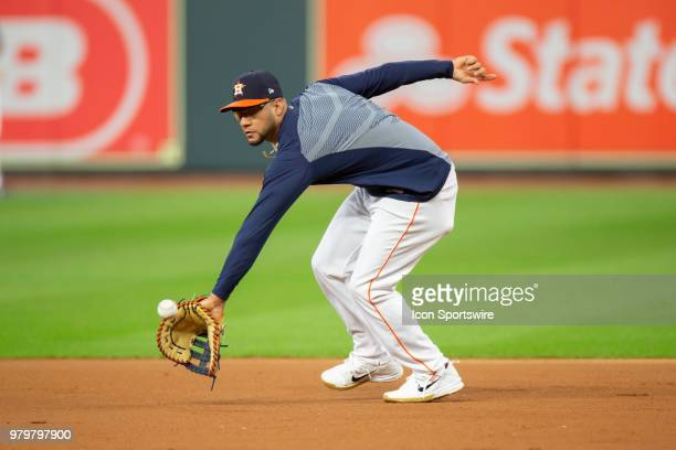 Houston Astros third baseman Yuli Gurriel fields a baseball during Astros batting prior to an MLB baseball game between the Houston Astros and the...