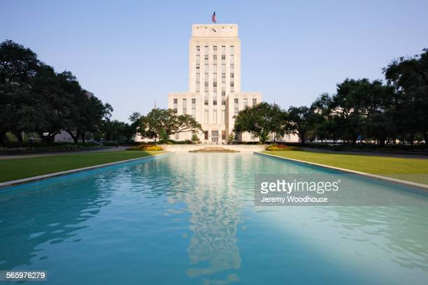 Houston City Hall over pond in urban park, Houston, Texas, United States
