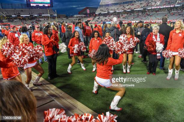 Houston Cougar cheerleaders have some fun warming up before the football game between the Temple Owls and Houston Cougars on November 10 2018 at...