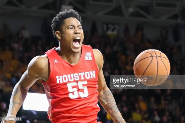 Houston Cougars center Brison Gresham yells after a dunk in the second half of an AAC basketball game between the Houston Cougars and Wichita State...