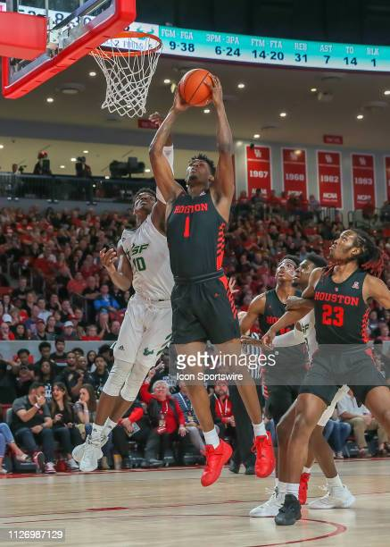 Houston Cougars center Chris Harris Jr beats South Florida Bulls forward Alexis Yetna to the rebound during the basketball game between the South...