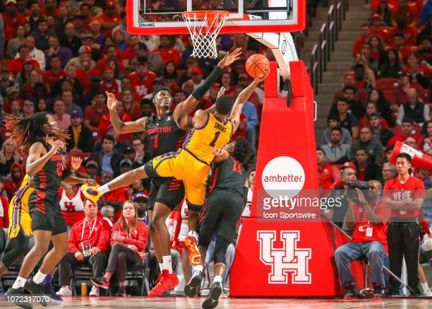 Houston Cougars center Chris Harris Jr blocks a shot by LSU Tigers guard Ja'vonte Smart during the basketball game between the LSU Tigers and Houston...