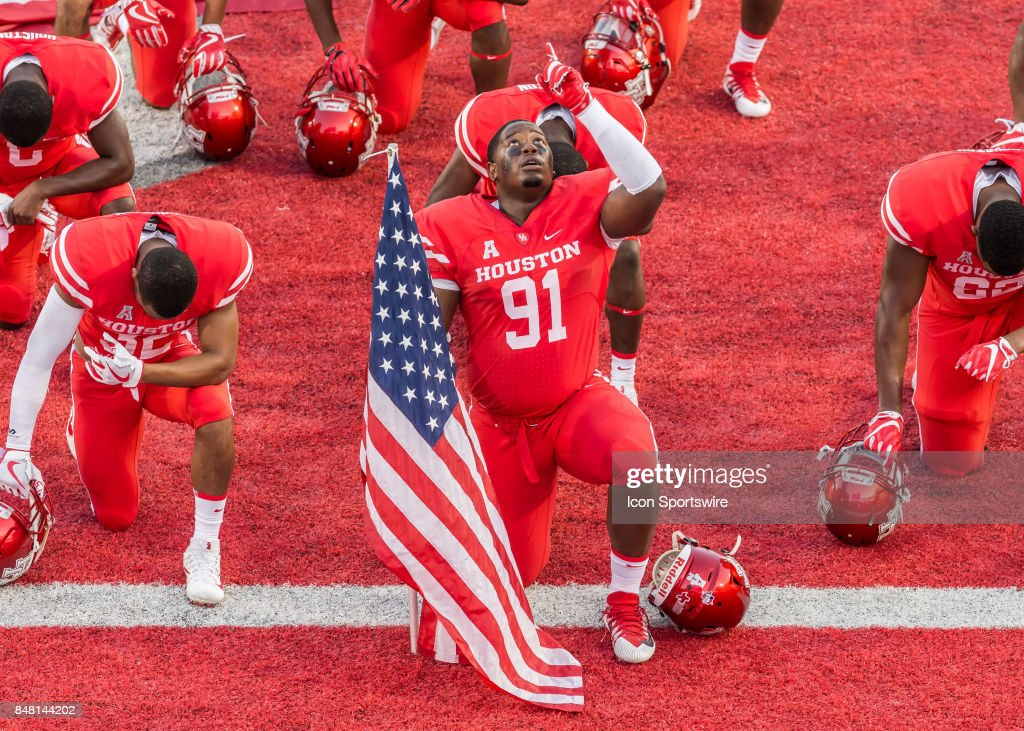 low priced 5f4ea bf566 Houston Cougars defensive end Nick Thurman says a prayer ...