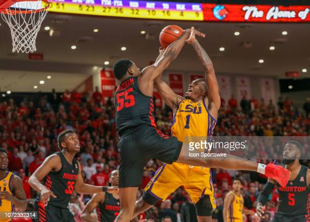 Houston Cougars forward Brison Gresham blocks a shot by LSU Tigers guard Ja'vonte Smart during the basketball game between the LSU Tigers and Houston...