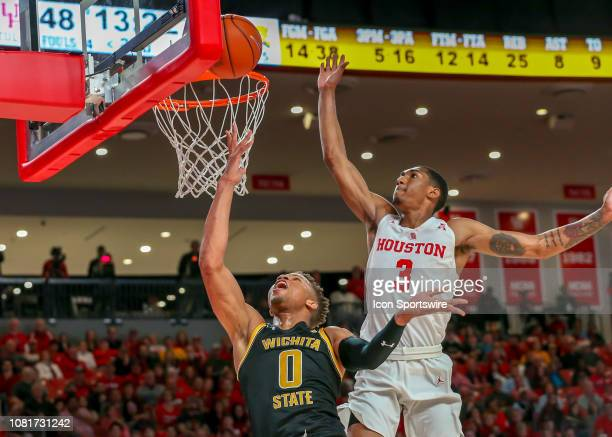 Houston Cougars guard Armoni Brooks tries to block a layup by Wichita State Shockers guard Dexter Dennis during the basketball game between the...