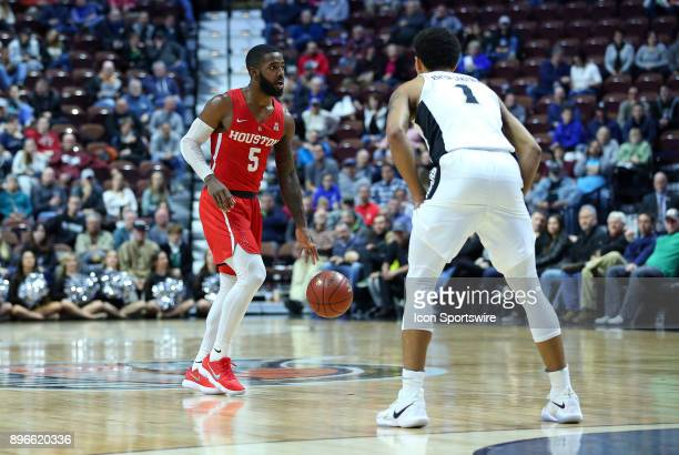Houston Cougars guard Corey Davis Jr and Providence Friars guard Makai AshtonLangford during a college basketball game between Houston Cougars and...