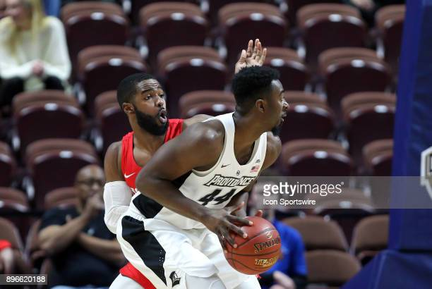 Houston Cougars guard Corey Davis Jr defends Providence Friars guard Isaiah Jackson during a college basketball game between Houston Cougars and...