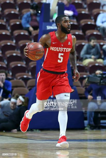 Houston Cougars guard Corey Davis Jr dribbles the ball up court during a college basketball game between Houston Cougars and Providence Friars on...