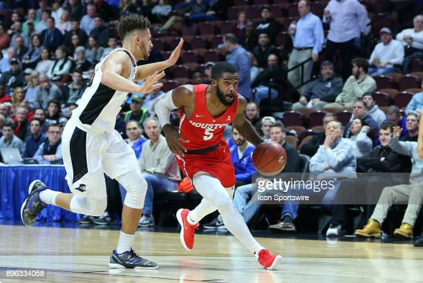 Houston Cougars guard Corey Davis Jr drives past Providence Friars guard Drew Edwards during a college basketball game between Houston Cougars and...