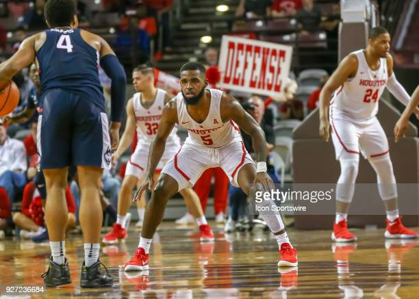 Houston Cougars guard Corey Davis Jr guards Connecticut Huskies guard Jalen Adams during the men's basketball game between the UConn Huskies and...