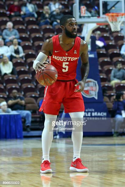 Houston Cougars guard Corey Davis Jr with the ball during a college basketball game between Houston Cougars and Providence Friars on December 20 at...