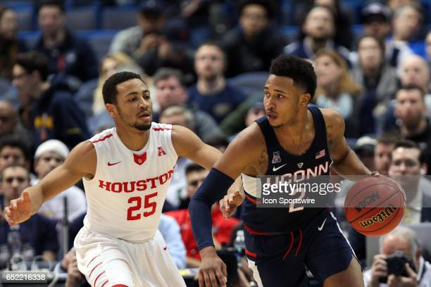 Houston Cougars guard Galen Robinson Jr persues UConn Huskies guard Jalen Adams during the first half of the American Athletic Conference...