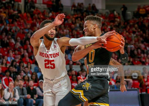 Houston Cougars guard Galen Robinson Jr reaches to take the ball from Wichita State Shockers guard Dexter Dennis during the basketball game between...