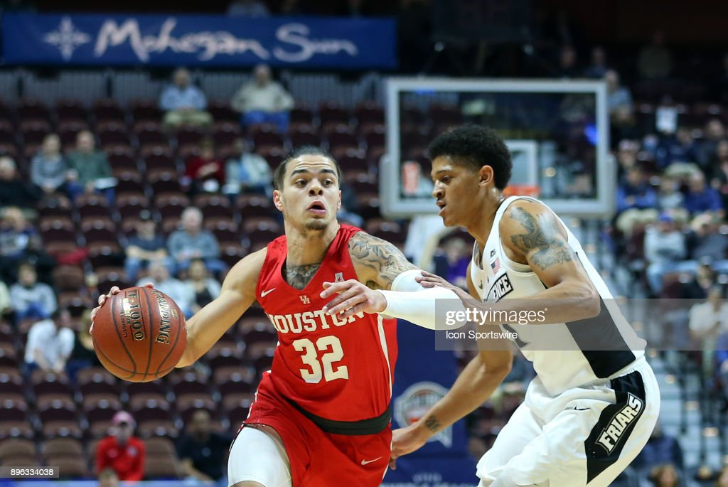 Houston Cougars guard Rob Gray (32) drives past Providence Friars guard Makai Ashton-Langford (1) during a college basketball game between Houston Cougars and Providence Friars on December 20, 2017, at Mohegan Sun Arena in Uncasville, CT. Houston defeated Providence 70-59.