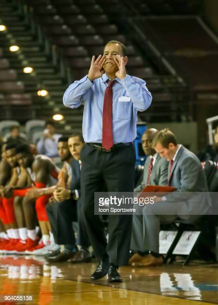 Houston Cougars head coach Kelvin Sampson calls out to players during the basketball game between the Tulsa Golden Hurricane and Houston Cougars on...