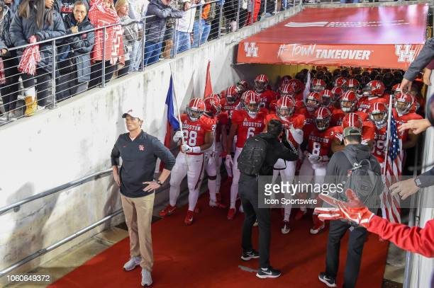 Houston Cougars head coach Major Applewhite prepares to lead his team onto the field before the football game between the Temple Owls and Houston...