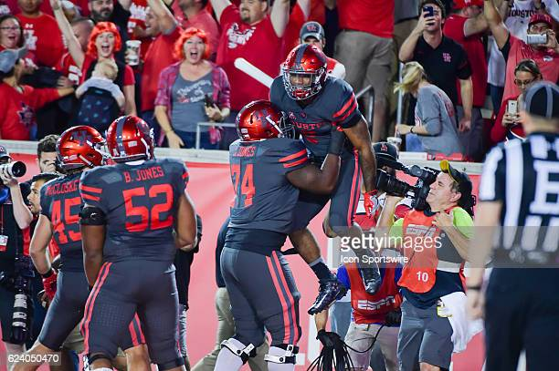 Houston Cougars offensive linesman Josh Jones hoists Houston Cougars running back Duke Catalon high in the air to celebrate Catalon's opening play...