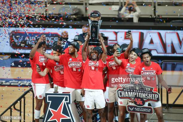 Houston Cougars players celebrate with the trophy after winning the Air Force Reserve American Athletic Conference Championship game between...