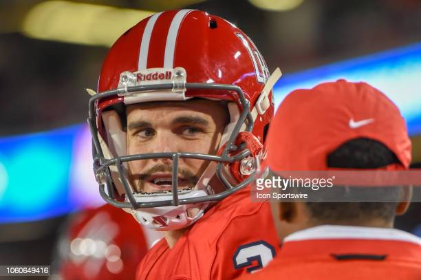 Houston Cougars punter Dane Roy chats on the sideline during the football game between the Temple Owls and Houston Cougars on November 10 2018 at...