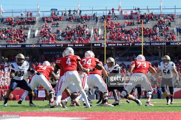 Houston Cougars quarterback D'Eriq King hands off to Houston Cougars running back Mulbah Car for a short gain as the defense collapses on the ball...