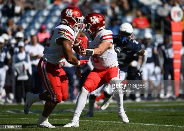 Houston Cougars quarterback Logan Holgorsen hands the ball off to Houston Cougars running back Kyle Porter during the game between the UConn Huskies...
