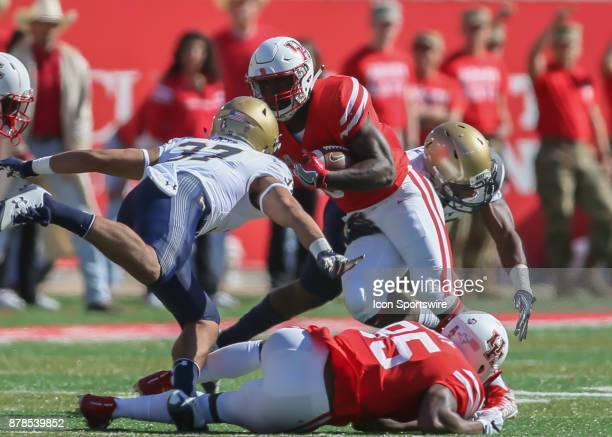 Houston Cougars running back Mulbah Car carries the ball during the football game between the Navy Midshipmen and Houston Cougars on November 24 2017...