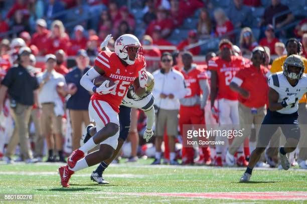 Houston Cougars wide receiver Linell Bonner looks for running room after catching a short pass in the flat during the football game between the Navy...