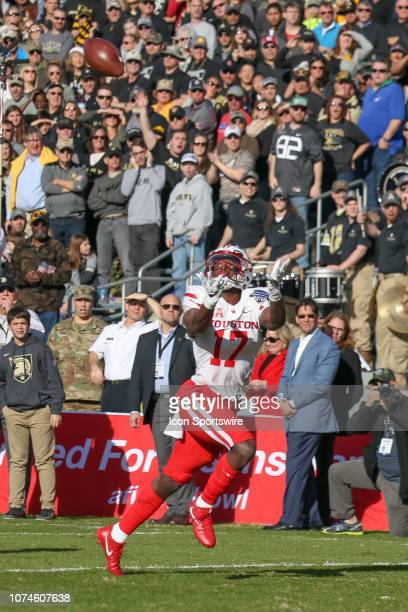 Houston Cougars wide receiver Terry Mark stretches for a pass during the Armed Forces Bowl between the Houston Cougars and Army Black Knights on...