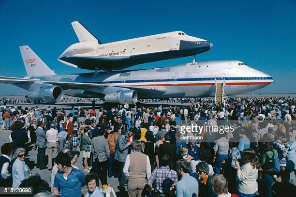 Crowds surround the Space Shuttle Enterprise and its 747 piggyback carrier after the aircrafts' arrival at Ellington Air Force Base